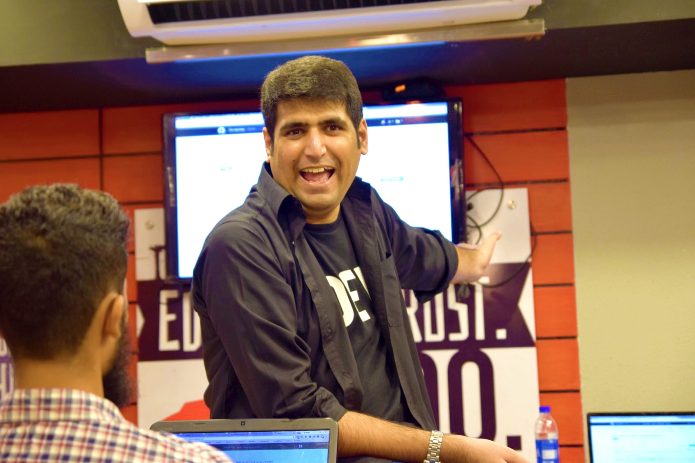 Ahmad Awais cracking jokes on Hacktoberfest Event